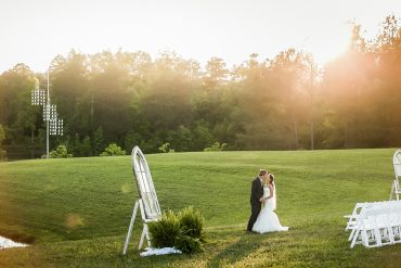 Breathtaking image of a bride and groom kissing in the sunset, Easley, SC