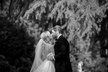 Romantic wedding couple kiss at Gassaway Mansion in Greenville, SC